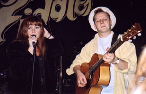 Kirsty MacColl and Mark Nevin on stage at the Mean Fiddler, London