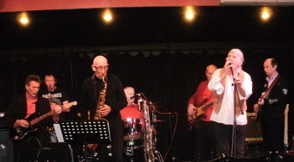 he reunited All Night Workers playing at The Bull's Head in Barnes, May 2012 From left to right: Dave Mumford, guitar; Pete Bower, Saxophone; Mel Wayne,  sax and harmonica; John Sergeant, drums; Brian Hosking, bass, Clive (Clyde) Barrow, vocals; Doug Ayris, guitar.