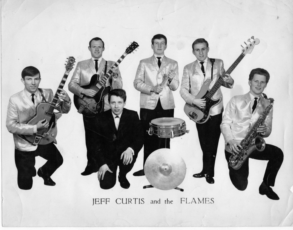 Left to right: Louis McKelvey (lead guitar); Keith Gardiner (rhythm guitar), Jeff Curtis (lead vocals); Malcolm Tomlinson (drums); Dave Wiggington (bass) and Malcolm Tagg-Randall (saxophone)